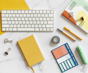 keyboard-surrounded-by-colorful-stationery_23-2148319726